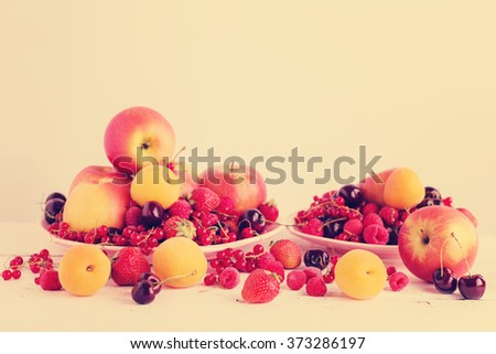 Fruits and berries (apples, apricots, raspberries. strawberry, currant, cherry), selective focus. - stock photo