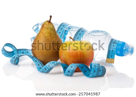 Fruits and bottle of water on white background - stock photo
