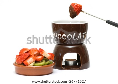 Fruits and chocolate fondue - stock photo
