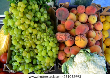 Fruits and vegetables at a farmers market for sale - stock photo