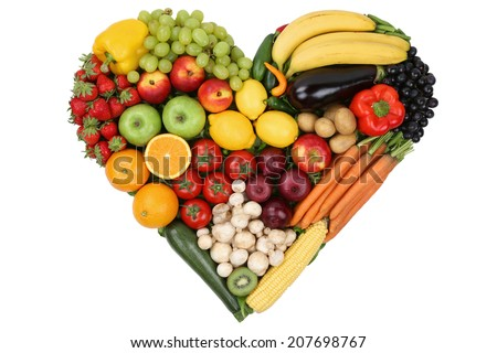 Fruits and vegetables forming heart love topic and healthy eating, isolated - stock photo