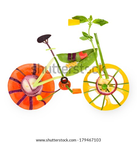 Fruits and vegetables in the shape of a bicycle in detail. - stock photo
