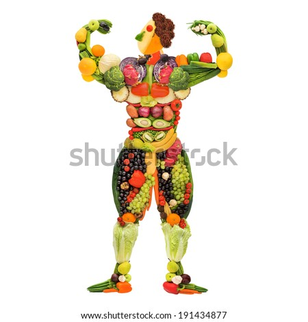 Fruits and vegetables in the shape of a healthy posing muscular bodybuilder. - stock photo