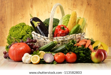 Fruits and vegetables in wicker basket - stock photo
