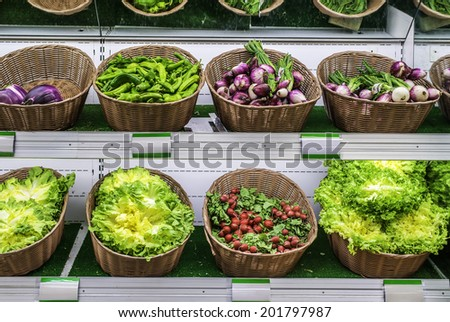 Fruits and vegetables on a supermarket shelf - stock photo