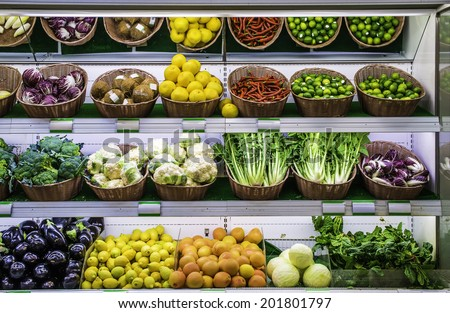 Fruits and vegetables on a supermarket shelf. - stock photo