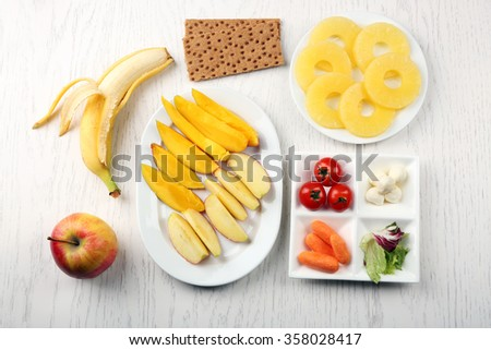 Fruits and vegetables on light wooden background. Healthy eating concept.  - stock photo