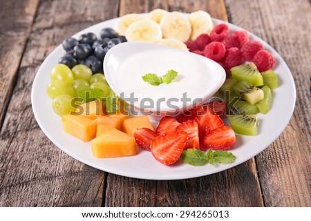 fruits and yogurt dip - stock photo