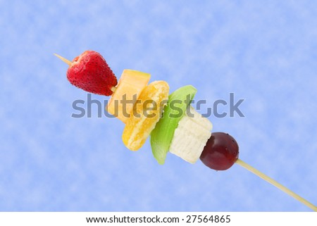 Fruits brochette. It has a clipping path. - stock photo