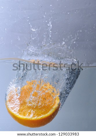 fruits fall deeply under water - stock photo