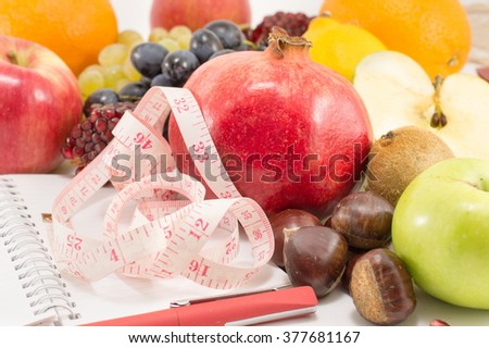 fruits notebook and a tape measure close up - stock photo