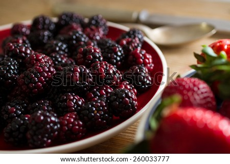 Fruits of the forest:  blackberries. Healthy breakfast food. - stock photo
