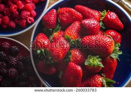 Fruits of the forest: strawberries, raspberries and blackberries. Healthy breakfast food. - stock photo