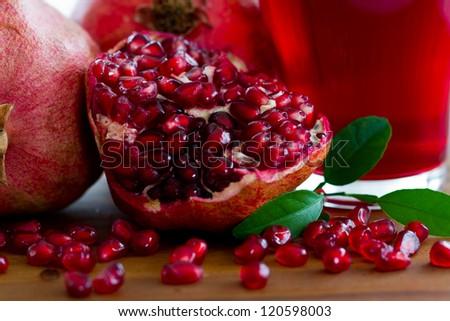 Fruits - Pomegranates and pomegranate juice - stock photo