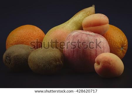 Fruits still life on black background - stock photo