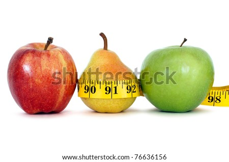fruits with measure tape over white background, clipping path - stock photo