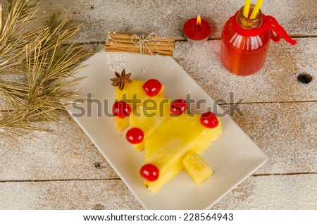 Fruity Christmas tree, a healthy kid dessert - stock photo