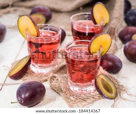 Fruity fresh Plum Liqueur Shots - stock photo