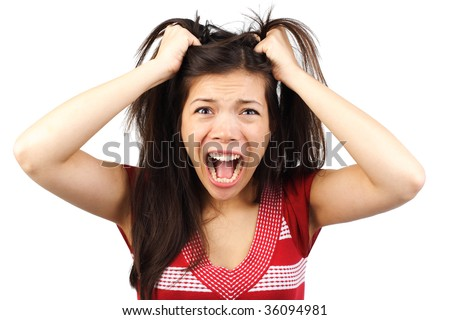 Frustrated and angry mad woman going crazy hands pulling her hair. Isolated on white background - stock photo