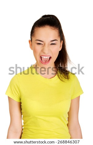 Frustrated and angry teen woman screaming. - stock photo