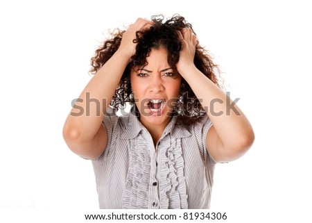 Frustrated angry stressed formal corporate business woman with curly hair with hands in hair and screaming yelling, isolated. - stock photo