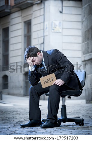 frustrated Business Man sitting on Office Chair on Street crying in stress - stock photo