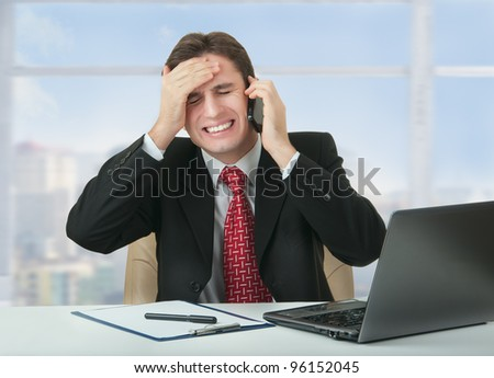 frustrated business man talking on the phone,  businessman lost, is under stress - stock photo