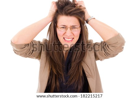 frustrated business woman in stress pulling hair - stock photo