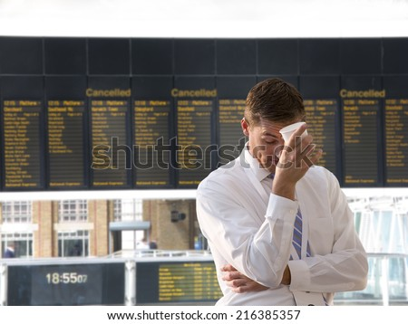 Frustrated businessman in airport - stock photo