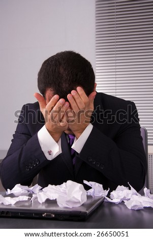 Frustrated businessman looking on disaster. - stock photo