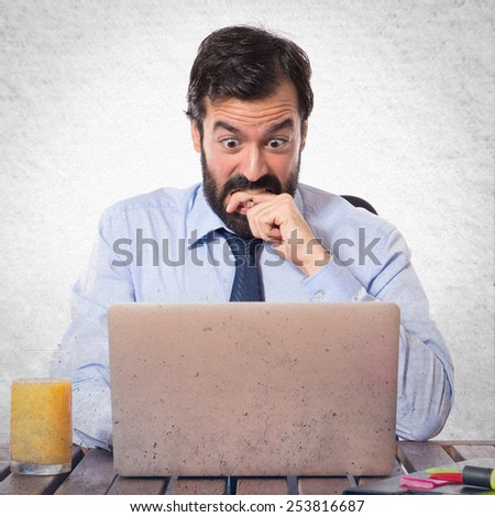 frustrated businessman over textured background  - stock photo