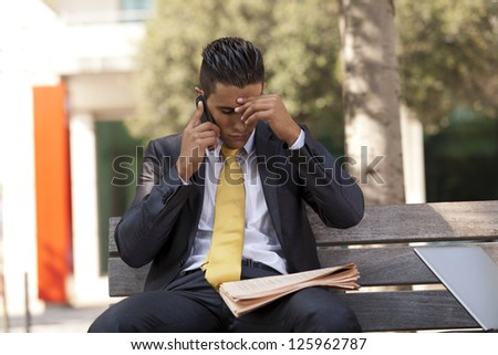 frustrated businessman sit at the bench park - stock photo