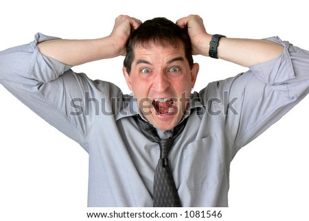 Frustrated businessman, with sleeves rolled up and tie loosened, screaming and pulling his hair. - stock photo