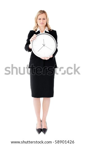 Frustrated businesswoman holding a clock against white background - stock photo