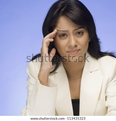 Frustrated businesswoman thinking - stock photo