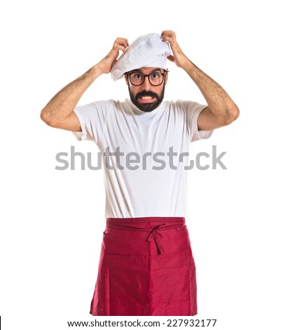 Frustrated chef over white background - stock photo