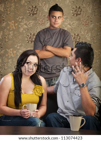 Frustrated father and mother with disrespectful son - stock photo