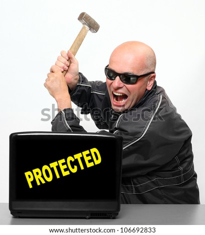 Frustrated hacker and protected laptop. - stock photo