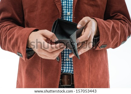 frustrated man holding an empty wallet in the hands - stock photo