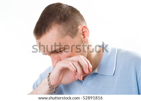 frustrated man in a blue shirt on a white - stock photo