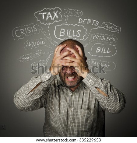 Frustrated man. Taxes, debts, credits and other problems.  - stock photo