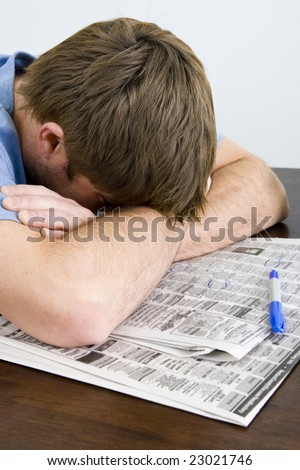 Frustrated man unable to find a job - stock photo