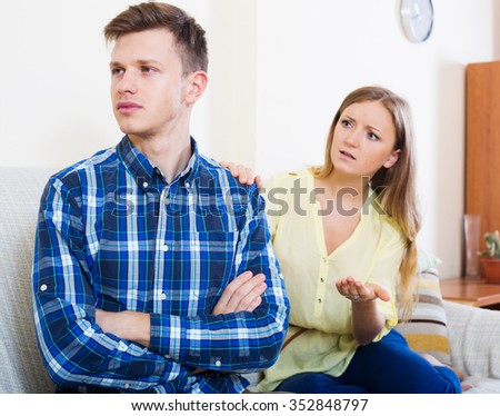 Frustrated partner cannot forgive another after conflict at living room - stock photo