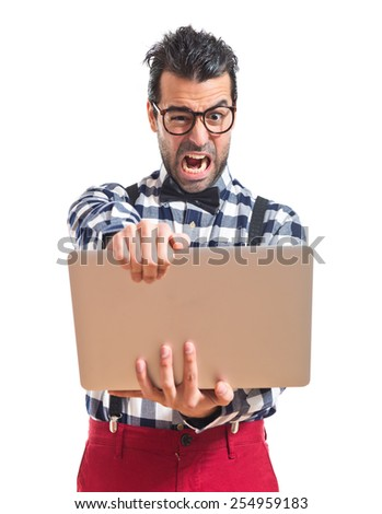 Frustrated posh boy with laptop over white background  - stock photo