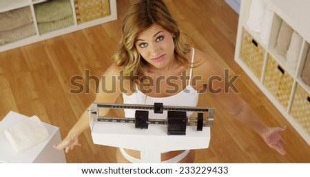 Frustrated woman unhappy with weight gain - stock photo