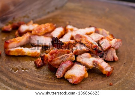 Fry pork./Fry pork chop into pieces on the cutting board. - stock photo