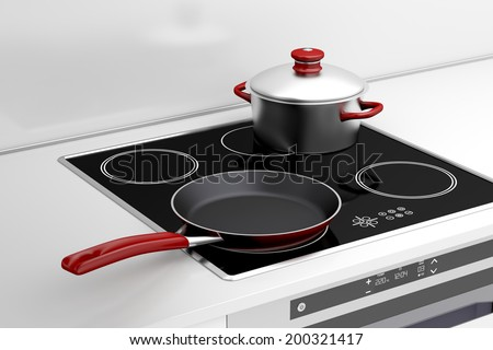 Frying pan and cooking pot at the induction stove - stock photo