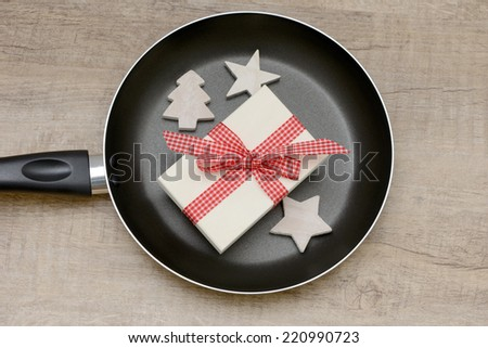 frying pan and present - stock photo