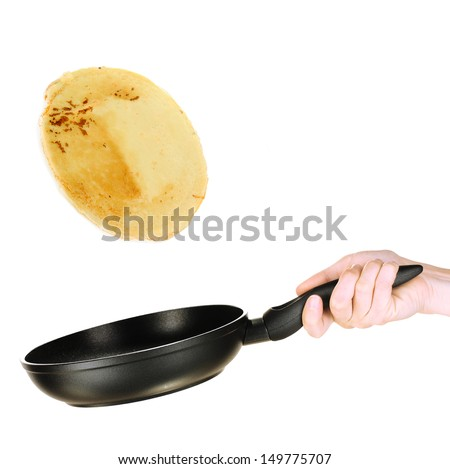 Frying pan with flying pancake - stock photo