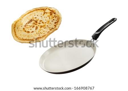 Frying pan with flying pancake - stock photo